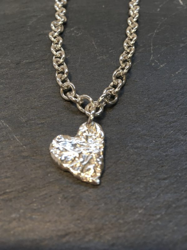 a chunky silver open link chain with a large reticulted heart dnagling from it created by Carol James of Silverfish Designs
