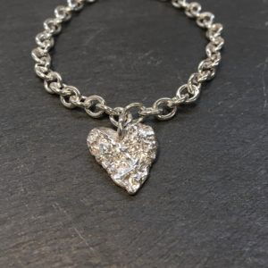 Melt My Heart bracelet, silver open link bracelet with large reticulated silver heart created by Carol James of Silverfish Designs
