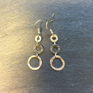 Sterling silver drop earrings, three open loops textured with a floral design witht the middle loop having an oxidised finish. silver jewellery designed by Carol James of Silverfish Designs