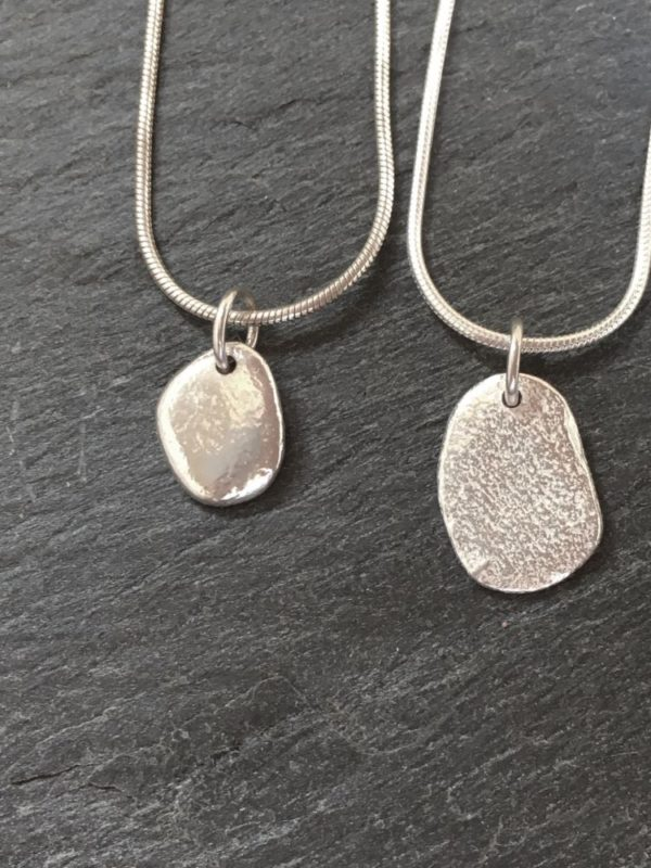 Small sterling silver pendant cast from beach pebbles from Anglesey. Designed and hand made by Carol James of Silverfish Designs