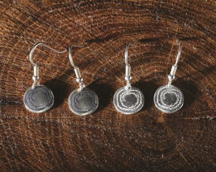 Simple disc drops ispired by prehistoric carvings from North Wales. Created by Carol James of Silverfish Designs