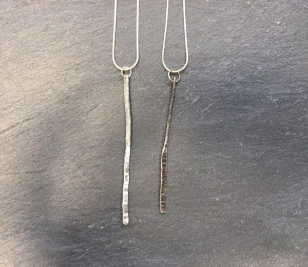 Sterling silver forged pendant on snake chain, a silver rod with a central twist and hammered detail. Designed and hand made by Carol James of Silverfish Designs