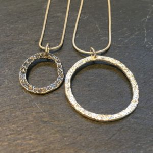 Flora bud round pendants from Silverfish Designs