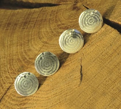 Silver stud earring inspired by the prehistoric carved stone at Llanbedr, created by Carol James of Silverfish Designs