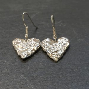 Sterling silver heart shaped drop earrings, formed by fusing and reticulating to give a lovely deep texture. Sterling silver jewellery designed and handmade by Carol James of Silverfish Designs.