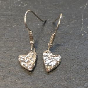 Tiny heart shaped drop earrings, reticulated to give a lovely textural finish. Designed and handmade by Carol James of Silverfish Designs.