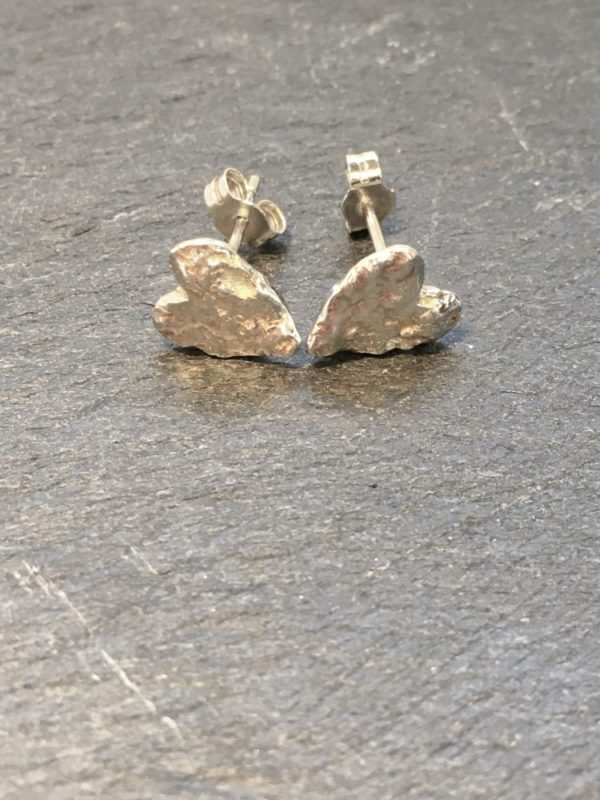 Tiny heart shaped stud earrings, reticulated to give a lovely textural finish. Designed and handmade by Carol James of Silverfish Designs.