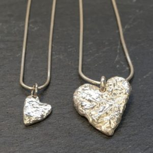 Tiny or large heart shaped pendant, reticulated to give a lovely textural finish. Designed and handmade by Carol James of Silverfish Designs.