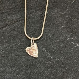 Tiny heart shaped pendant on snake chain, reticulated to give a lovely textural finish. Designed and handmade by Carol James of Silverfish Designs.