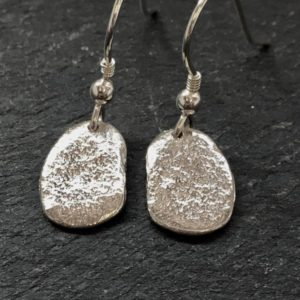 Small silver pebble drop earrings, handmade by Carol James of silverfish Designs