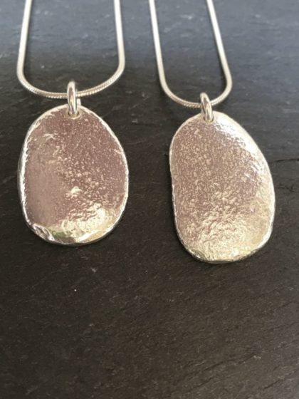 Large silver pendant cast from a natural beach pebble from Anglesey. Designed and handmade by Carol James of Silverfish Designs