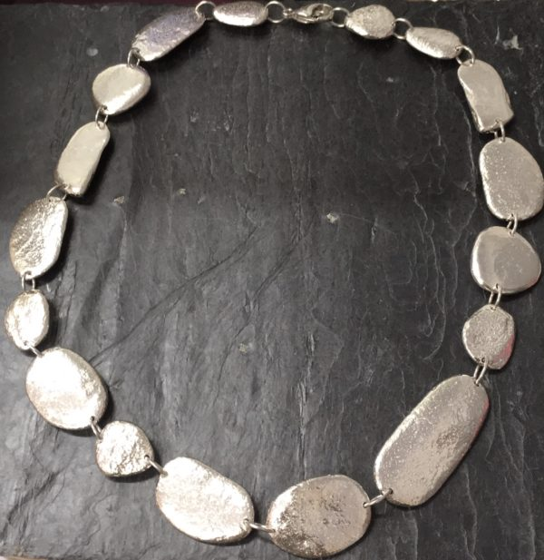 Pebble necklace cast from natural beach pebbles from a beach in Anglesey handmade by Silverfish Designs