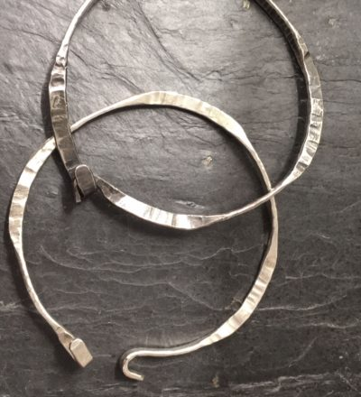 Detail of heavy, opening forged bangles